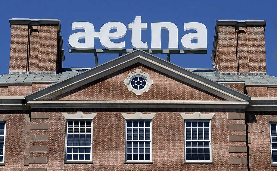 FILE  - In this Tuesday, Aug. 19, 2014, file photo, a sign for Aetna Inc., sits atop a building at the company headquarters in in Hartford, Conn. Health insurer Aetna Inc. has made a deal to buy competitor Humana Inc. in a $37 billion deal the companies say would create the second-largest managed care company, it was announced Friday, July 3, 2014. (AP Photo/Jessica Hill, File) Photo: Jessica Hill, Associated Press