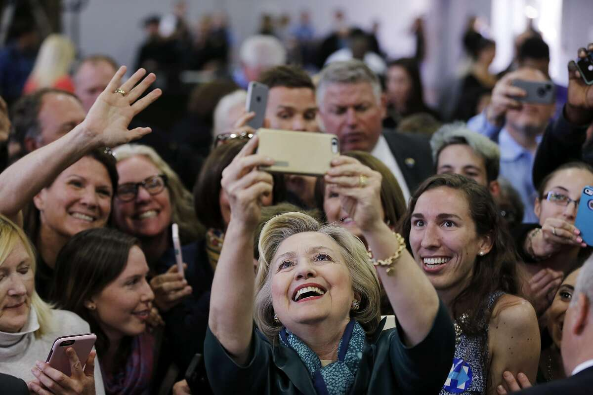 Democratic presidential candidate Hillary Clinton meets with attendees during a campaign stop, Sunday, April 24, 2016, at the University of Bridgeport in Bridgeport, Conn. (AP Photo/Matt Rourke)