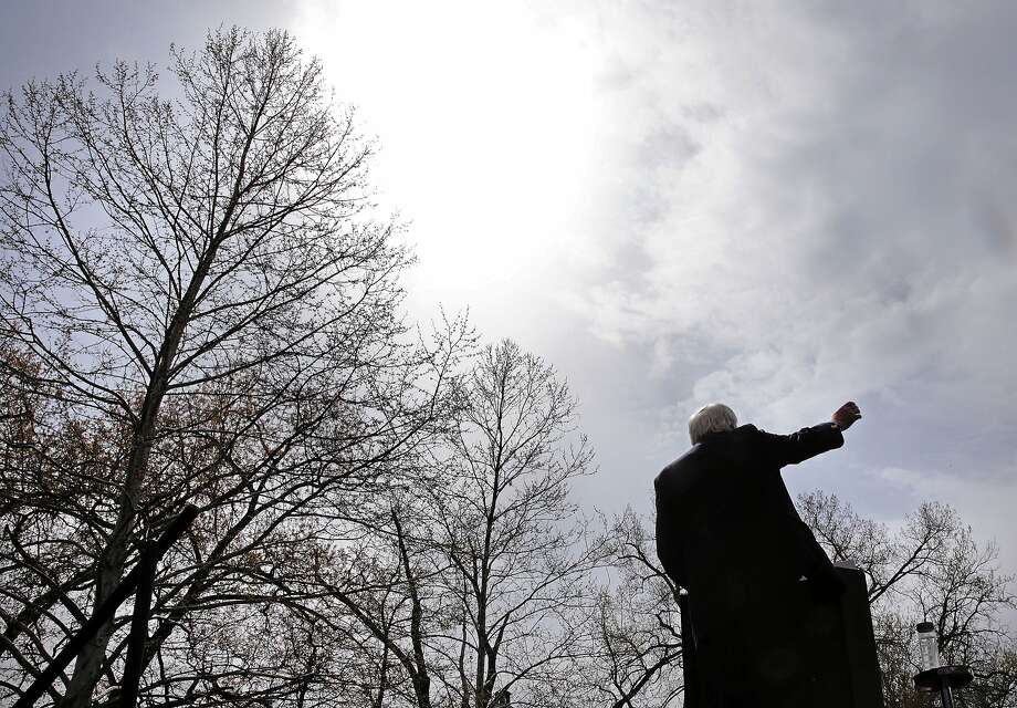 Backers of Sen. Bernie Sanders, shown above at a campaign rally in Hartford, Conn., are pinning nomination hopes on superdelegates. The margin for Hillary Clinton, top, is strong when superdelegates who say they support her are counted. Photo: Charles Krupa, Associated Press