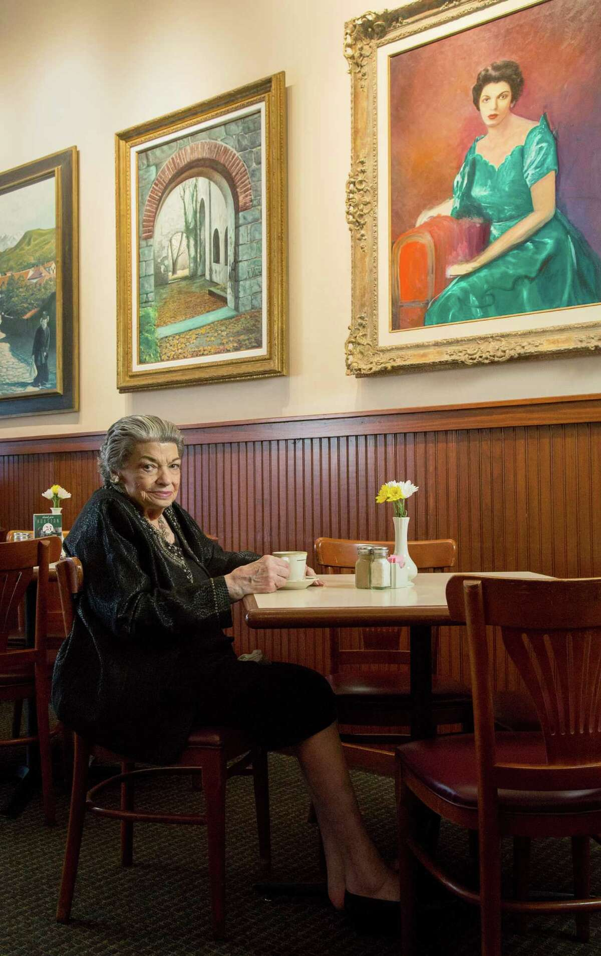 Pat Mickelis at Cleburne Cafeteria. Artwork on the walls of her restaurant were painted by her late husband, Nick.