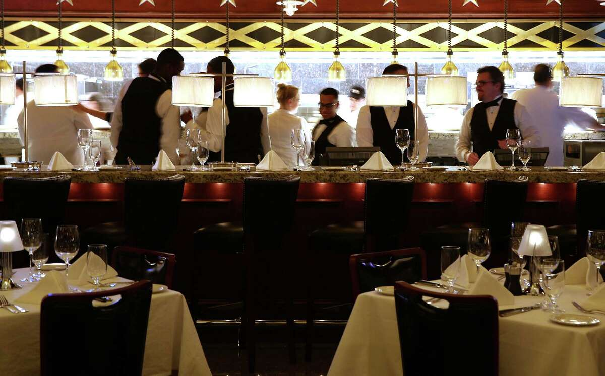 Wait staff and expediters prepare for a the evening at Pappas Bros. Steakhouse