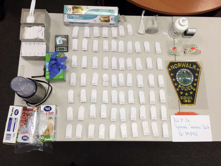 Norwalk police recently uncovered a drug factory in a Flax Hill Road condominium where they seized more than 670 packaged heroin and another 49 grams of the drug. Photo: Norwalk Police Dept. / Contributed Photo / Connecticut Post contributed
