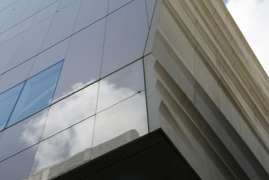 Clouds are reflected in the SFMOMA panels facing Howard Street. Photo: Suzuki, The Chronicle