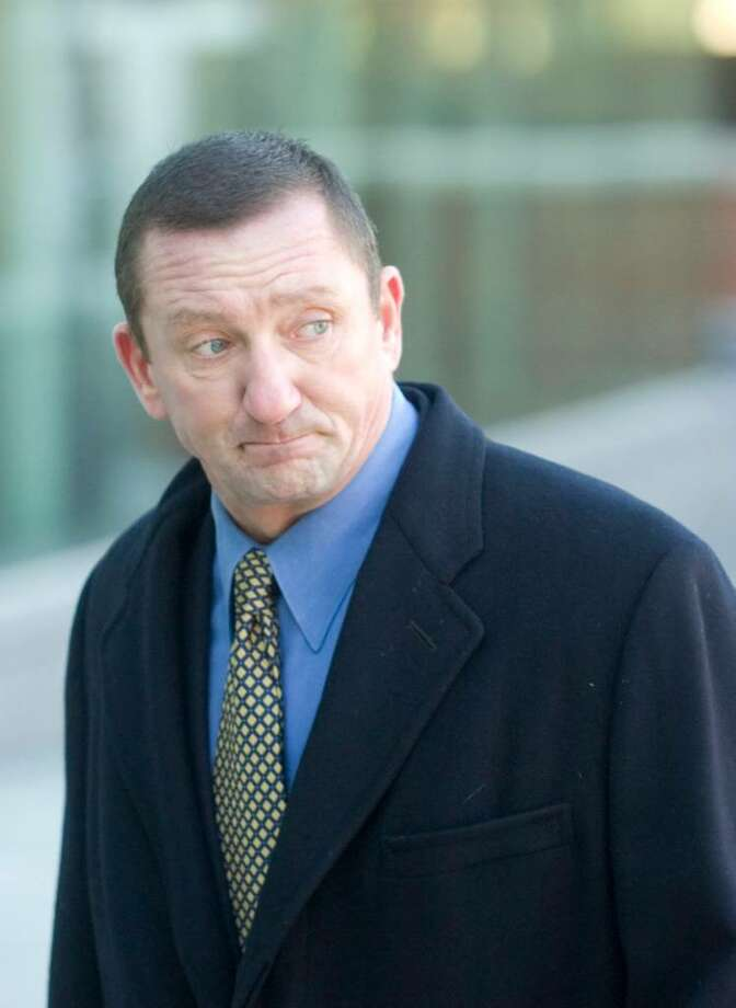 Former Norwalk Police Lt. Thomas Cummings arrives at Superior Court in Stamford, Conn. on Thursday, Feb. 14, 2008. Photo: File Photo / Stamford Advocate File Photo