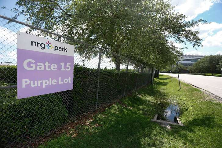 For seniors at 17 high schools in the Houston Independent School District, tack on a parking fee for graduation - $12 per car at NRG Park and $8 at Texas Southern University. ( Karen Warren  / Houston Chronicle )