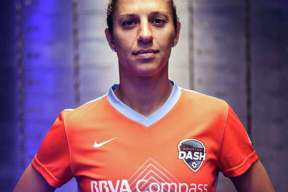 Houston Dash player Carli Lloyd poses for a photo in the team's 2016 uniforms on Thursday, April 14, 2016, in Houston. ( Elizabeth Conley / Houston Chronicle )