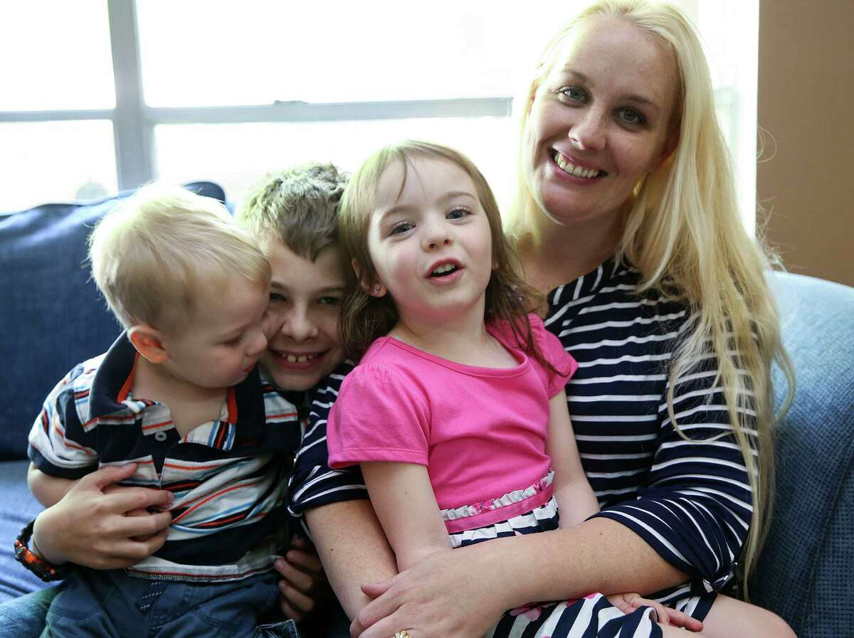 Now 4 and healthy, Cassandra Wells, in pink, was born with gastroschisis in 2011. She left the hospital after 37 days in the neonatal intensive care unit, and these days enjoys time with brothers Clark, 1, left, Charles, 10, and mom Sabrina Wells.