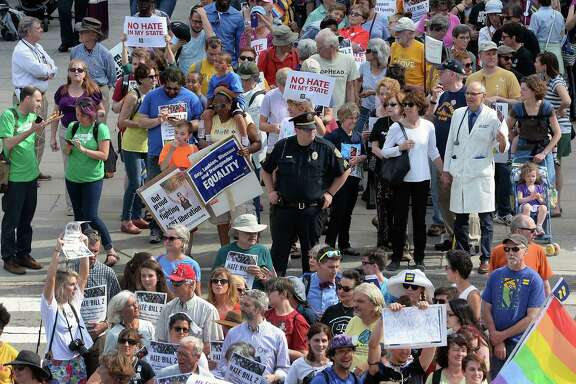 Protesters in Raleigh, N.C., head into the Legislative Building on Monday for a sit-in against House Bill2, the GOP-backed bill curtailing protections for LGBT people and limiting transgender bathroom choices.