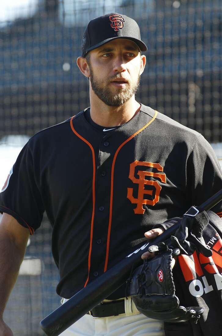 San Francisco Giants' Madison Bumgarner looks on during batting practice, before an exhibition baseball game against the Oakland Athletics, Friday, April 1, 2016 in San Francisco, Calif. (AP Photo/George Nikitin)