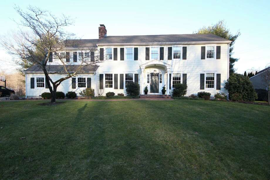 This four-bedroom colonial is on the Chasmars Pond cul de sac, known for hosting neighborhood block parties, picnics and holiday gatherings. Photo: Contributed Photos / Darien News