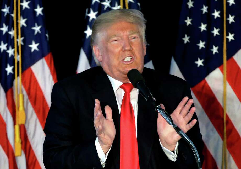 Republican presidential candidate Donald Trump addresses an audience during a campaign rally, Monday, April 25, 2016, in Warwick, R.I. (AP Photo/Steven Senne) ORG XMIT: RISR102 Photo: Steven Senne / Copyright 2016 The Associated Press. All rights reserved. This m