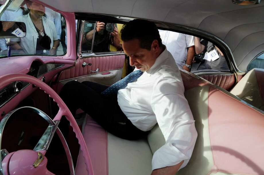 New York Governor Andrew Cuomo slides into a 1956 Chevrolet in Havana, Cuba, Monday, April 20, 2015. The formal state visit, a trip that makes Cuomo the first American governor to visit the island since the recent thaw in relations with the communist nation, is meant to foster greater ties between New York and Cuba. (AP Photo/Desmond Boylan) Photo: Desmond Boylan / AP