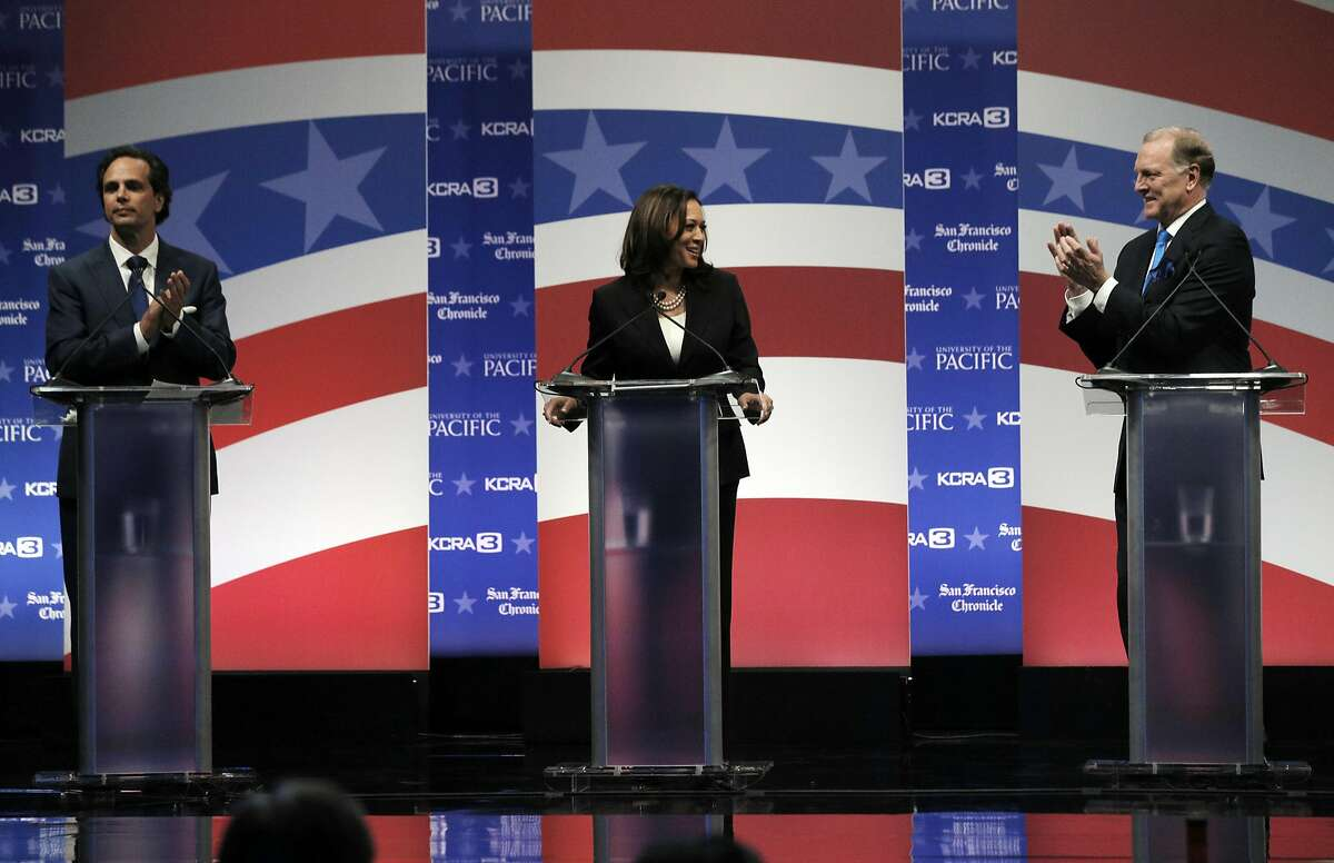 Tom Del Beccaro, left, and Duf Sundheim, right, applaud as Democratic state Attorney General Kamala Harris is introduced during a U.S. Senate debate at The University of the Pacific in Stockton, Calif., Monday, April 25, 2016. (Carlos Avila Gonzalez/The San Francisco Chronicle via AP, Pool)