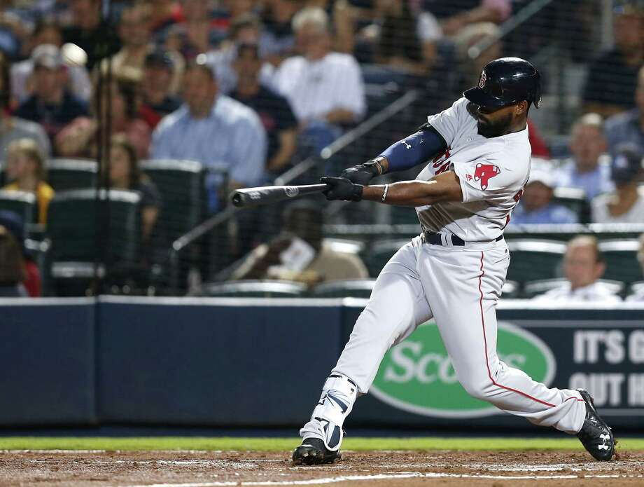 ATLANTA, GA - APRIL 25:  Centerfielder Jackie Bradley Jr. #25 of the Boston Red Sox hits a solo home run in the seventh inning during the game against the Atlanta Braves at Turner Field on April 25, 2016 in Atlanta, Georgia.  (Photo by Mike Zarrilli/Getty Images) ORG XMIT: 607676405 Photo: Mike Zarrilli / 2016 Getty Images