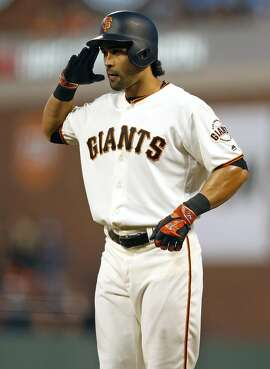 San Francisco Giants' Angel Pagan salutes after hitting RBI single in 2nd inning against San Diego Padres during MLB game at AT&T Park in San Francisco, Calif., on Monday, April 25, 2016.