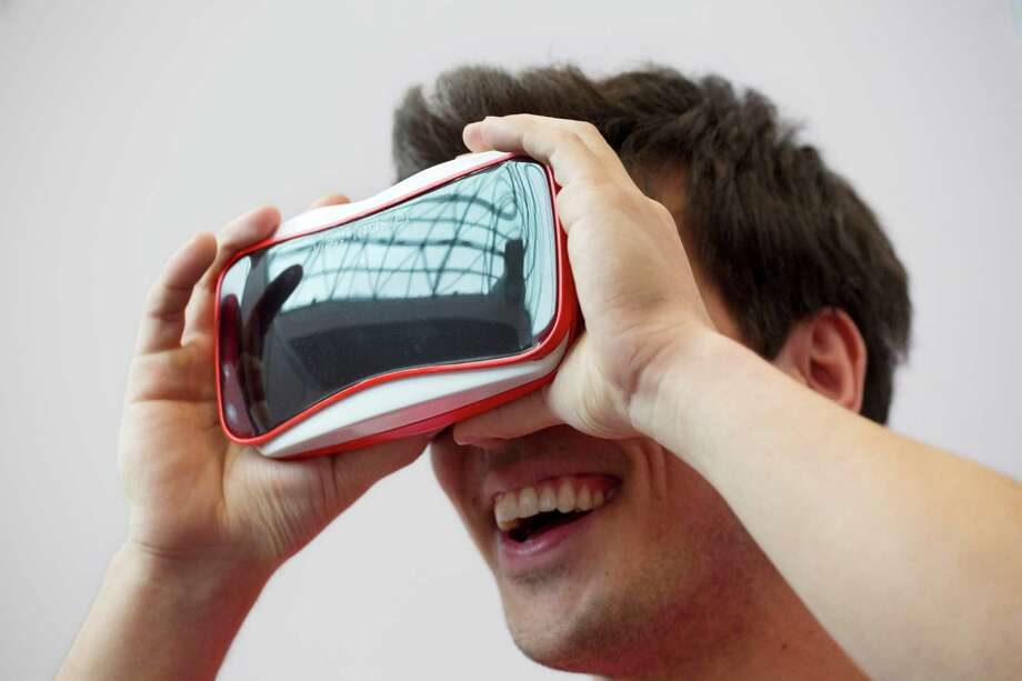 This version of a View-Master, a collaboration between Mattel and Google, was displayed last year. The classic toy makes use of Google's smartphone-based virtual-reality solution, the aptly named Google Cardboard.  Photo: Mark Lennihan, STF / AP
