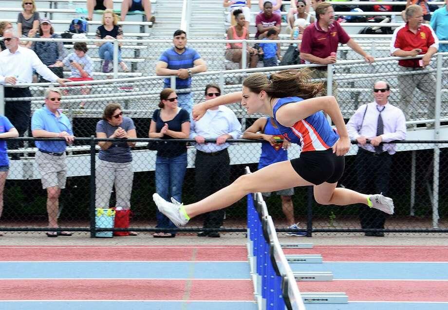 FILE PHOTO: Danbury High Schools Bridget Chiaravalle runs the Girls 100 meter Hurdles during the FCIAC Outdoor Track & Field Championships at Danbury High School on Tuesday, May 26, 2015. Photo: Lisa Weir / Lisa Weir / The News-Times Freelance