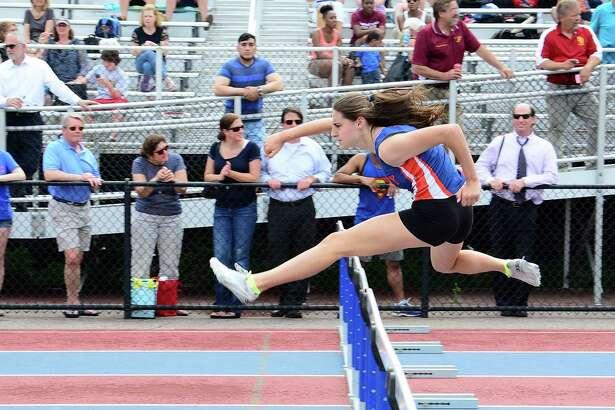 FILE PHOTO: Danbury High Schools Bridget Chiaravalle runs the Girls 100 meter Hurdles during the FCIAC Outdoor Track & Field Championships at Danbury High School on Tuesday, May 26, 2015.