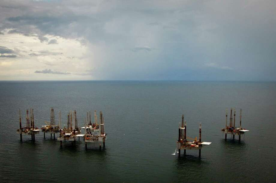 Shallow-water drilling rigs owned by Hercules Offshore were drilling near Port Fourchon, La.  Photo: Smiley N. Pool, HC Staff / Houston Chronicle
