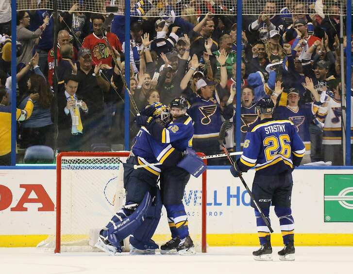 St. Louis Blues goaltender Brian Elliott, left, celebrates with center David Backes at the end of Game 7 in an NHL hockey first-round Stanley Cup playoff series in St. Louis on Monday, April 25, 2016. The Blues won, 4-3. (Chris Lee/St. Louis Post-Dispatch via AP) MANDATORY CREDIT
