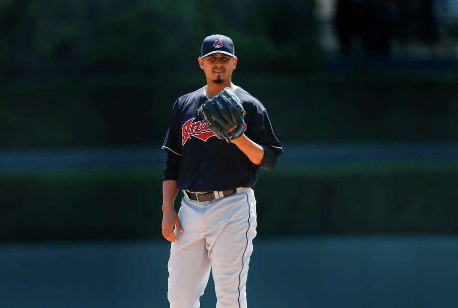 Cleveland Indians pitcher Carlos Carrasco warms up against the Detroit Tigers in the first inning of a baseball game, Sunday, April 24, 2016, in Detroit. (AP Photo/Paul Sancya) Photo: Paul Sancya, STF / AP