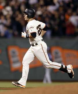 San Francisco Giants' Buster Posey rounds the bases after 7th inning home run against San Diego Padres during MLB game at AT&T Park in San Francisco, Calif., on Monday, April 25, 2016.