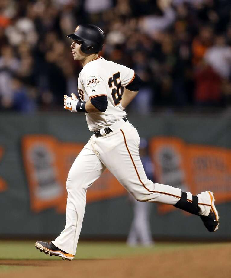San Francisco Giants' Buster Posey rounds the bases after 7th inning home run against San Diego Padres during MLB game at AT&T Park in San Francisco, Calif., on Monday, April 25, 2016. Photo: Scott Strazzante, The Chronicle