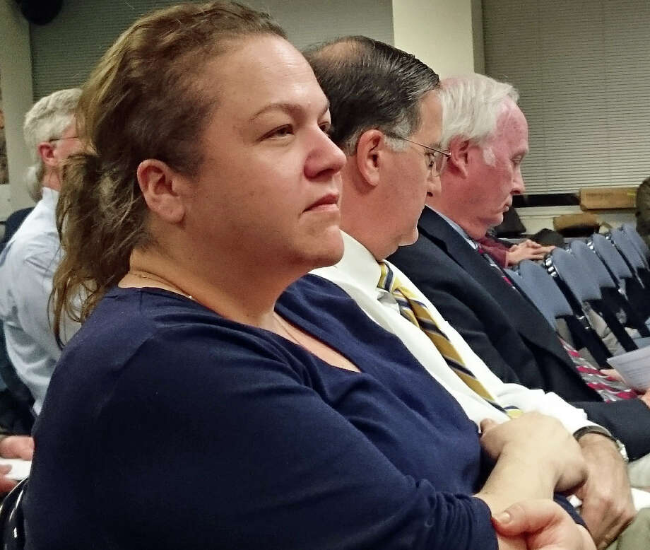 Board of Education member Trish Pytko was on hand, along with Supt. of Schools David Title, and Phil Dwyer, school board chairman, for Monday's Representative Town Meeting. Photo: Genevieve Reilly / Hearst Connecticut Media / Fairfield Citizen
