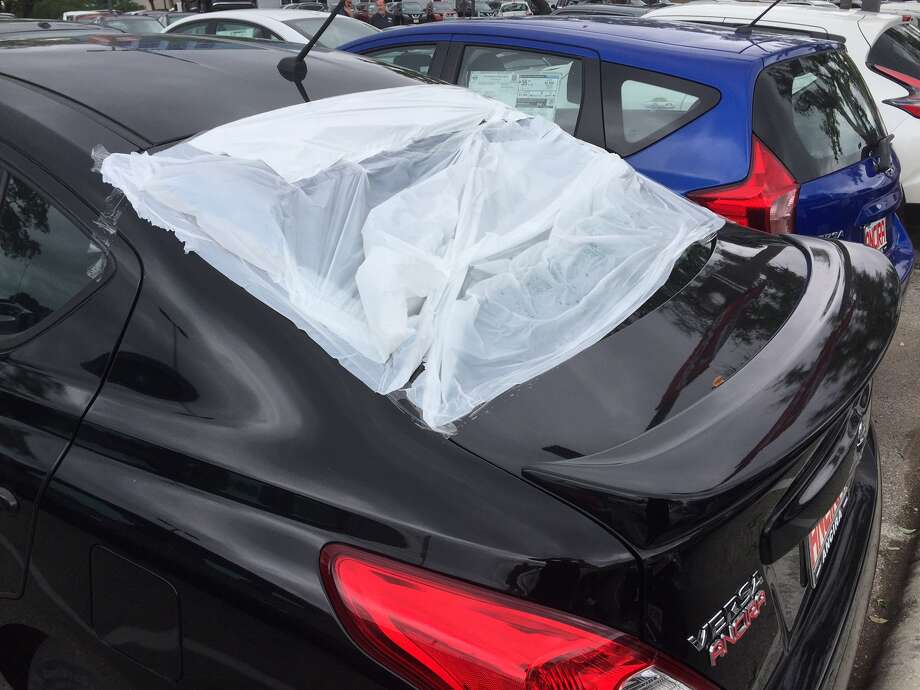 Ancira Nissan said 75 percent of their 1,200-car inventory was affected by the second round of hail this month, on April 25. Photo: Jason Thompson