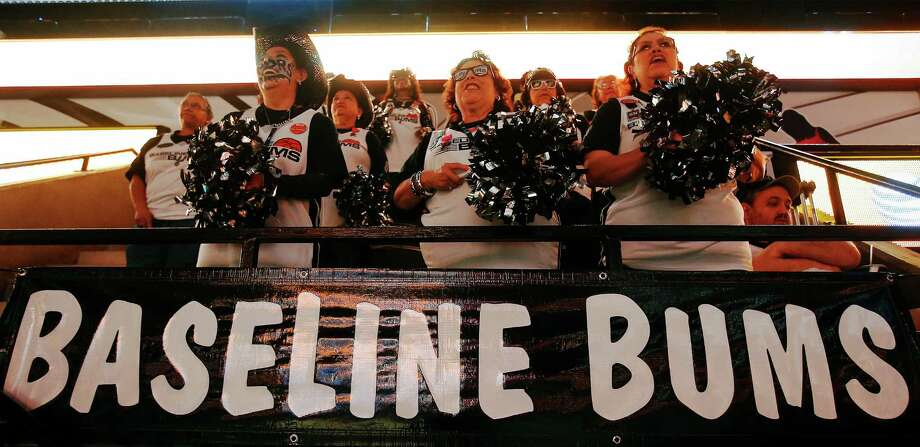 Baseline Bums Brenda Flores (from left), Adele Vasquez and Deborah Darron help lead their section in cheering during the Spurs game against the Oklahoma City Thunder at the AT&T Center on Tuesday, Apr. 12, 2016. Photo: Kin Man Hui /San Antonio Express-News / ©2016 San Antonio Express-News