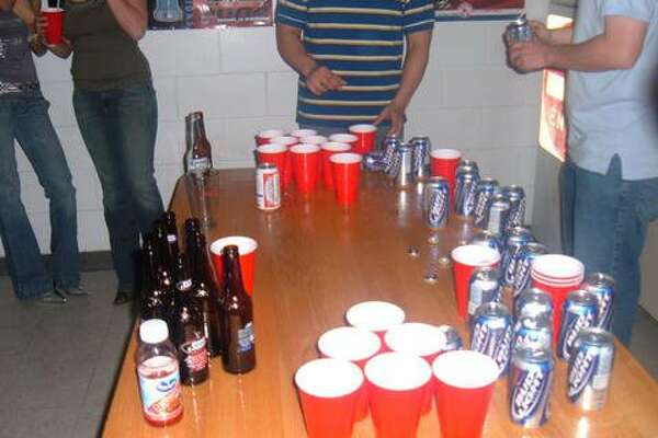 In this file photo group of teens play a game of beer pong, a popular drinking game.