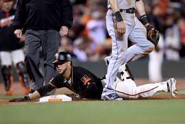 SAN FRANCISCO, CA - APRIL 23:  Gregor Blanco #7 of the San Francisco Giants dives into third base with his second triple of the night against the Miami Marlins in the bottom of the eighth inning at AT&T Park on April 23, 2016 in San Francisco, California.  (Photo by Thearon W. Henderson/Getty Images)