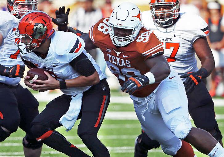 Longhorns defensive tackle Hassan Ridgeway gets through to Cowboys quarterback Mason Rudolph as Texas hosts Oklahoma State at Royal-Memorial Stadium on Sept. 26, 2015.
