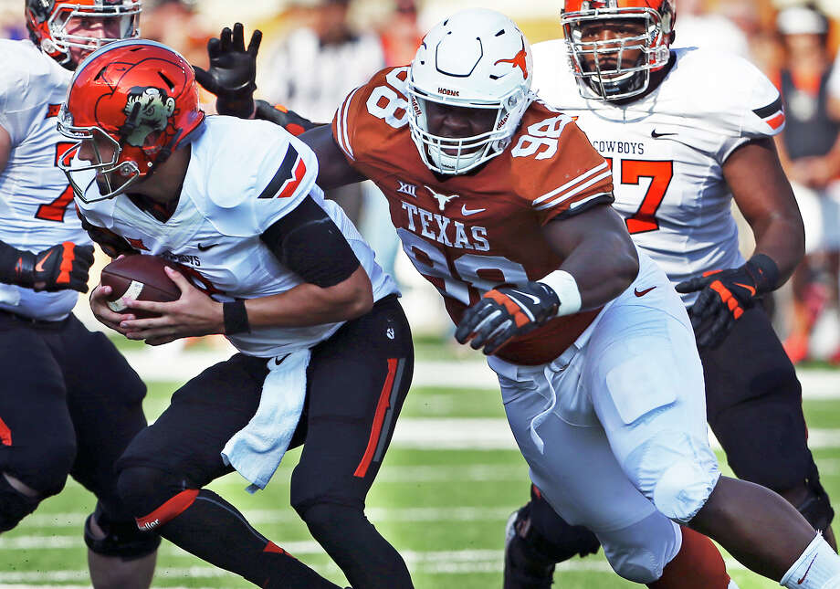 Longhorns defensive tackle Hassan Ridgeway gets through to Cowboys quarterback Mason Rudolph as Texas hosts Oklahoma State at Royal-Memorial Stadium on Sept. 26, 2015. Photo: Tom Reel /San Antonio Express-News