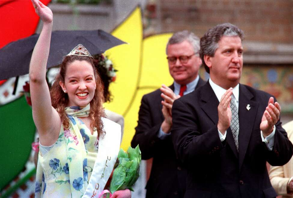 5/9/98, Albany, NY-- Katie O'Mally, from Delmar,NY, left, waves to the crowd after being crowned the Tulip Queen at the Tulip Festival, Saturday. At right is Albany City Mayor Jerry Jennings. (Steve Jacobs/Times Union)