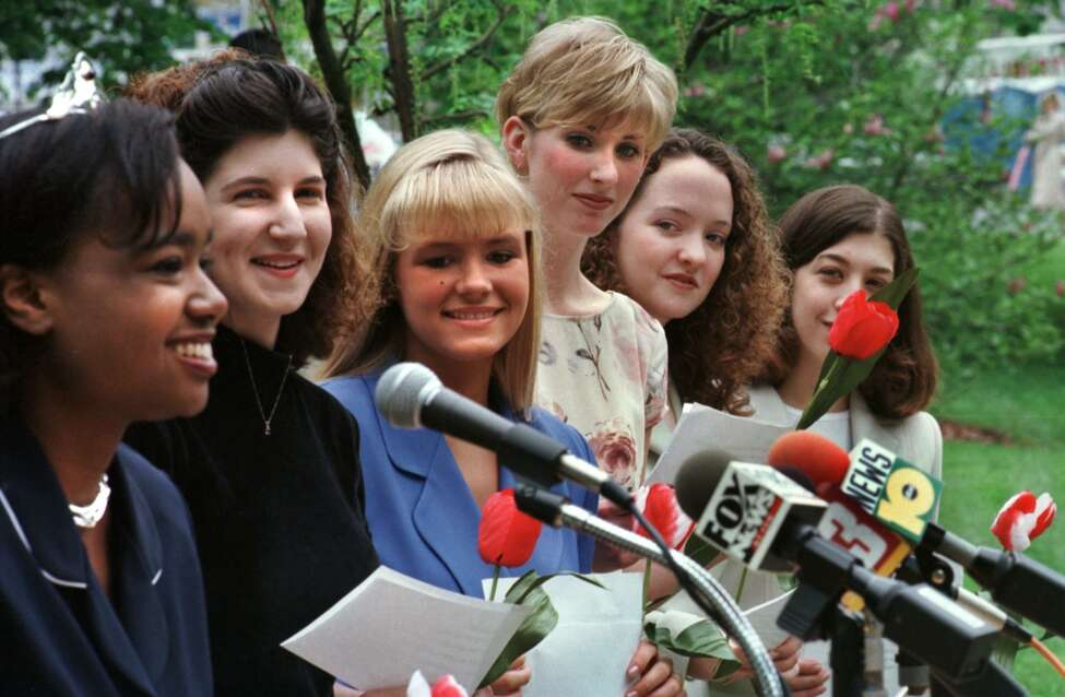 MONDAY MAY 4 1998 -- ALBANY NY -- Christina Leann Roberts, FAR LEFT, 1997 Tulip Queen, addresses the media during a press conference announcing the 1998 Tulip Queen candidates. The candidates are, Jessica Giordano, SECOND FROM LEFT, Alaina McAuliffe, THIRD FROM LEFT, Erin Murray, THIRD FROM RIGHT, Katie O'Malley, SECOND FROM RIGHT, and Lisa Pettinato, FAR RIGHT. (Paul Buckowski/Times Union)