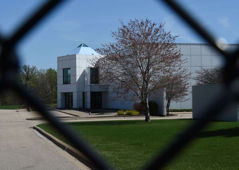 The entrance of the Paisley Park compound of music legend Prince is seen through a fence in Minneapolis, Minnesota, on April 22, 2016, who died suddenly at the age of 57. There was no evidence of trauma on Prince's body when he was found unresponsive at his Minnesota compound, and his death is not thought to be a suicide, authorities said. / AFP / Mark Ralston (Photo credit should read MARK RALSTON/AFP/Getty Images)