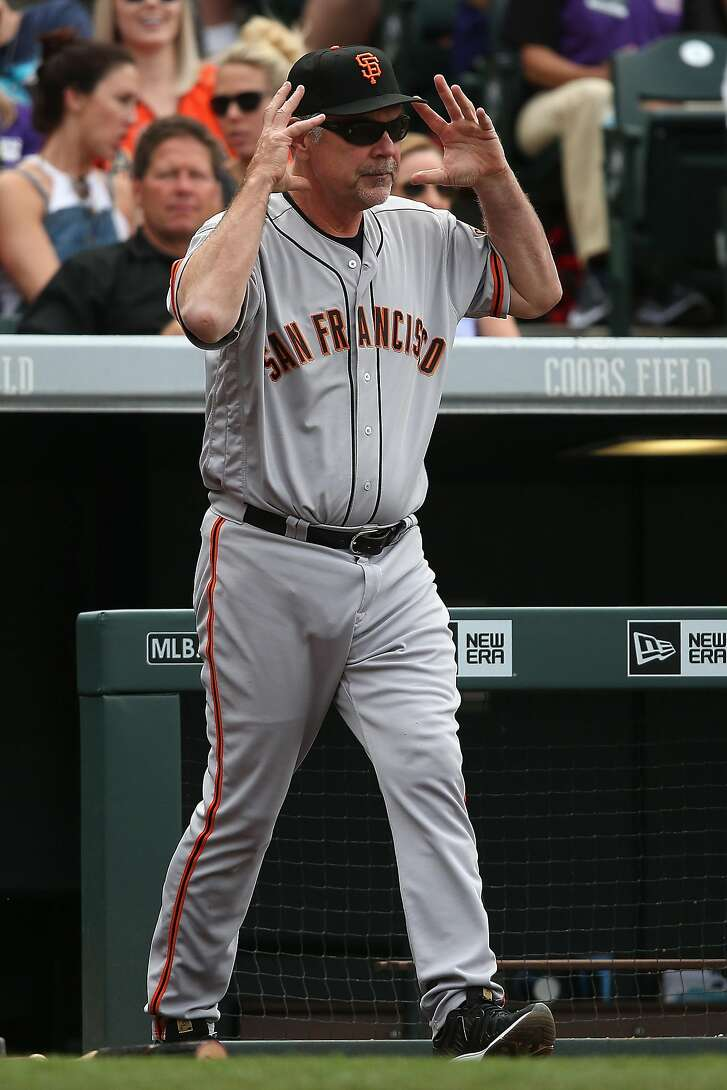 DENVER, CO - APRIL 14:  Manager Bruce Bochy #15 of the San Francisco Giants calls for a video review of a fly ball by Brandon Belt #9 of the San Francisco Giants that was overturned by review to a two run home run as the Colorado Rockies held a 9-6 lead in the eighth inning at Coors Field on April 14, 2016 in Denver, Colorado. The Rockies defeated the Giants 11-6.(Photo by Doug Pensinger/Getty Images)