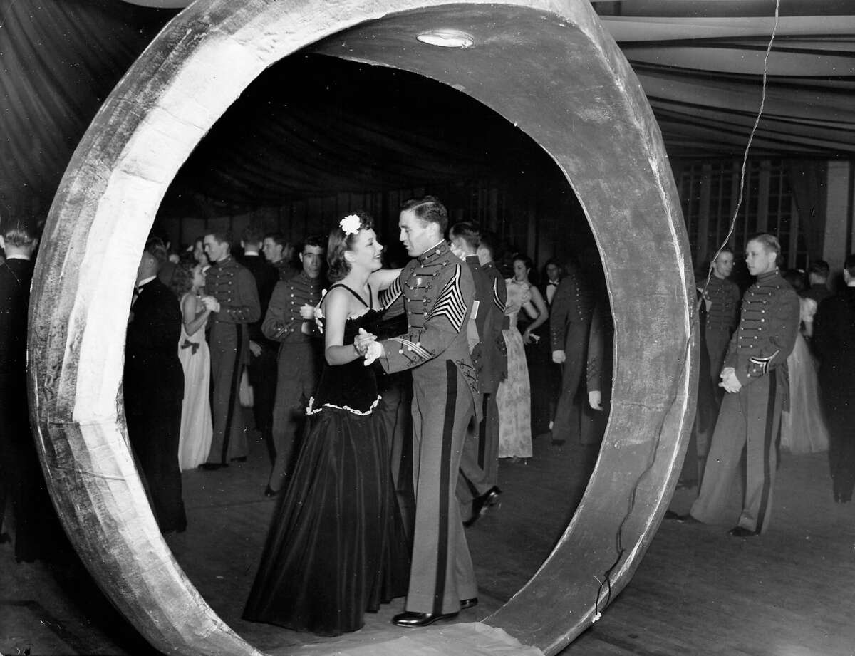 Mary Joyce Walsh (CL) dancing with date at The Citadel's prom.