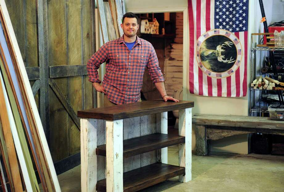 Jared Rohrig, Owner Of Wood + Grit, Poses At His Shop On Woodmont Road