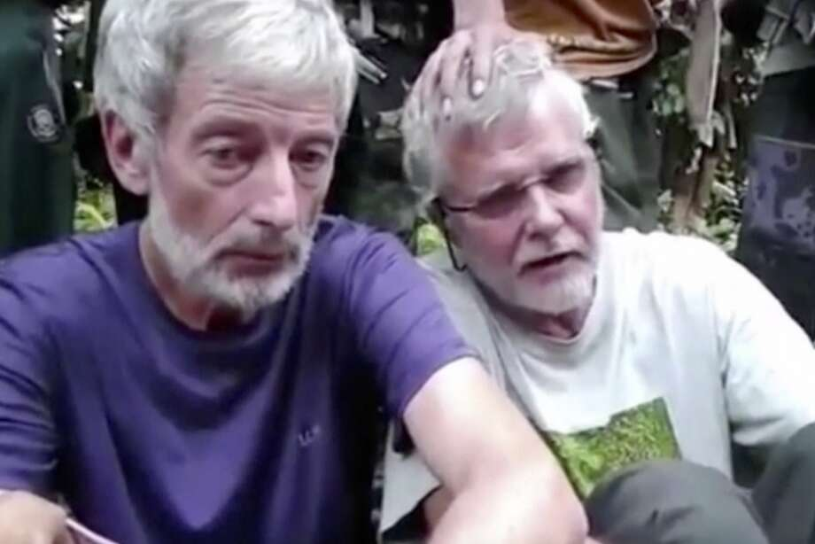 Canadians John Ridsdel (right) and Robert Hall appear in this image made from an undated militant video. Photo: Associated Press