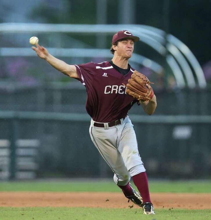 Clear Creek third baseman Landon Etzel throws to first early in game 2 of the Class 6A Region 3 Finals at Reckling Park Friday, June 5, 2015, in Houston. ( Jon Shapley / Houston Chronicle )