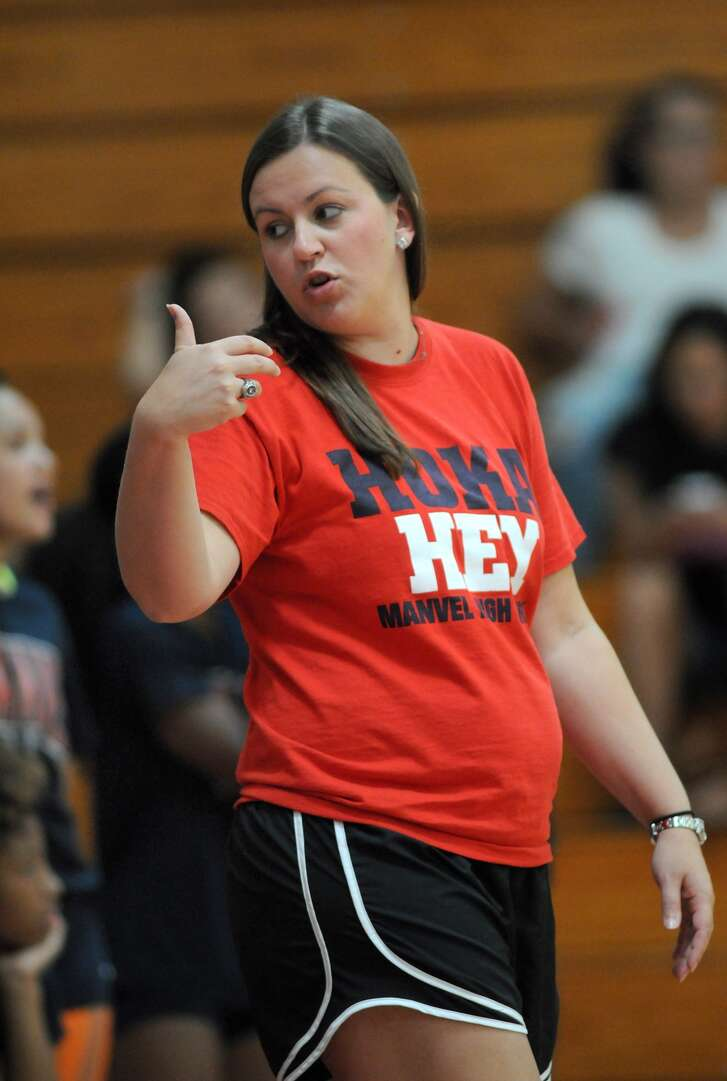 Manvel head volleyball coach Sarah Paulk coaches up her team against La Porte during a four-way scrimmage at Clear Brook High School.