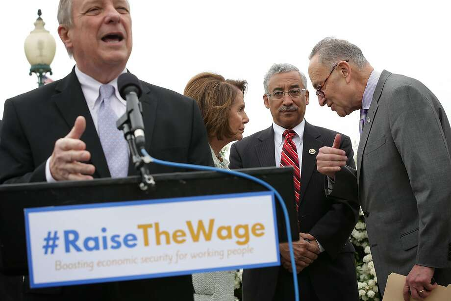 Sen. Richard Durbin calls for a raise in the federal minimum wage, backed by Rep. Nancy Pelosi (second from left), Rep. Bobby Scott and Sen. Chuck Schumer on Thursday. Photo: Alex Wong, Getty Images