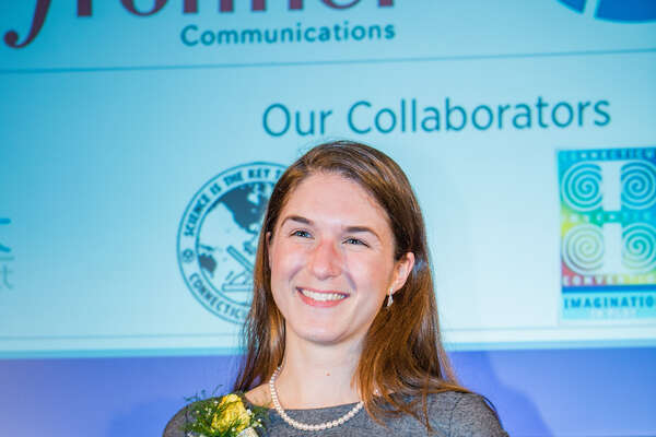 Nicole Bucala, CEO of MIFCOR, with her award from the Connecticut Technology Council.