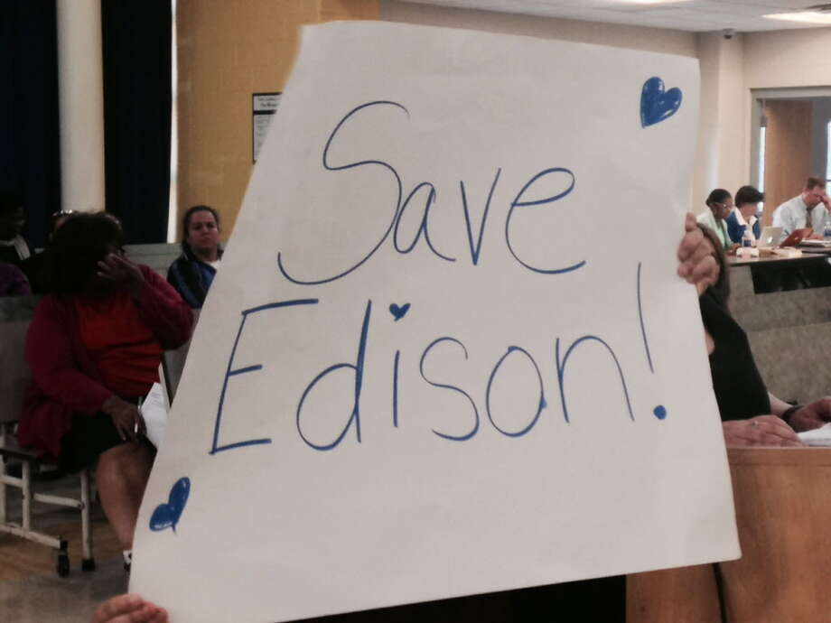 Edison parents brought signs to urge Bridgeport BOE to keep their school open Photo: Contributed / Contributed
