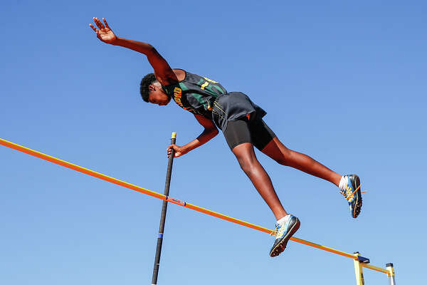 Christyan Sampy of Stratford High School clears the 10 ft. mark in the 5A/6A Men's Pole Vault event at the UIL Area Track Meet held at Seven Lakes High School on April 22, 2015.