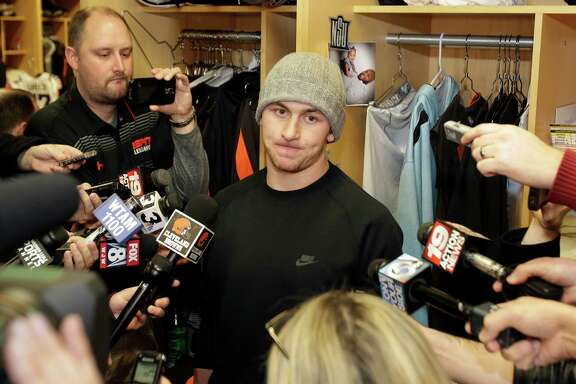 In this Dec. 29, 2014, file photo, then-Cleveland Browns quarterback Johnny Manziel talks with the media at the NFL football team's training camp, in Berea, Ohio. Johnny Manziel was indicted by a grand jury on April 26, 2016, on misdemeanor charges stemming from a domestic violence complaint by his ex-girlfriend.