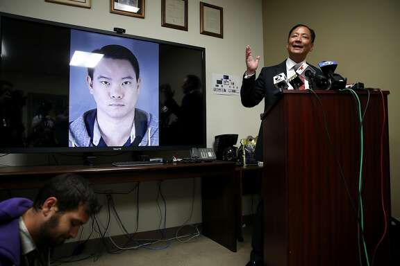 Public Defender Jeff Adachi speaks to journalists about recently uncovered racist text messages sent by San Francisco Police Officer Jason Lai (on screen) during a press conference in San Francisco, California, on Tuesday, April 26, 2016.