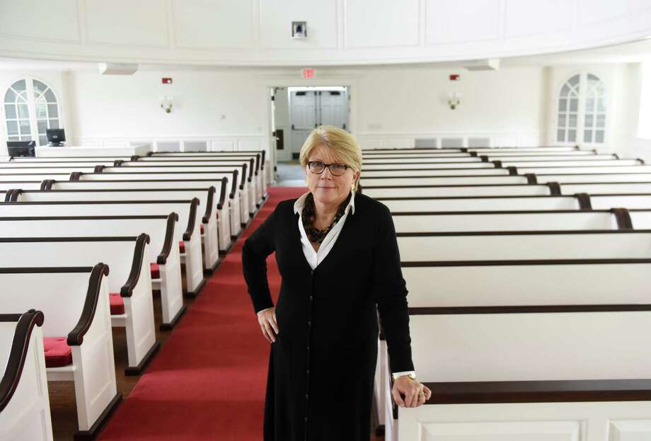 "Pastor Jacky Gatliff in the santuary at Stanwich Congregational Church in Greenwich on Monday. Gatliff is working on advancing her Memory in the Mirror workshop, designed to help women deal with the loss of their mothers. Gatliff said a difficult relationship can make grieving complicated when the mother is gone. ""There are things we wish we had done or not done,"" she said. Photo: Tyler Sizemore / Hearst Connecticut Media / Greenwich Time"